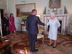 Queen Elizabeth II greets King Abdullah II of Jordan, ahead of Crown Prince Hussein of Jordan and Queen Rania of Jordan, during a private audience at Buckingham Palace, London.