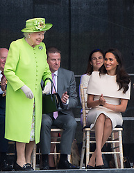 Queen Elizabeth ll and Meghan, Duchess of Sussex open the New Mersey Gateway Bridge during a visit to Cheshire on June 14, 2018.  This is the Duchess's first solo engagement with The Queen