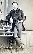 portrait man leaning on writing desk late 1800s