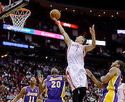 Nov 7, 2013; Houston, TX, USA; Houston Rockets point guard Jeremy Lin (7) lays in a shot against the Los Angeles Lakers during the second quarter at Toyota Center. Mandatory Credit: Thomas Campbell-USA TODAY Sports