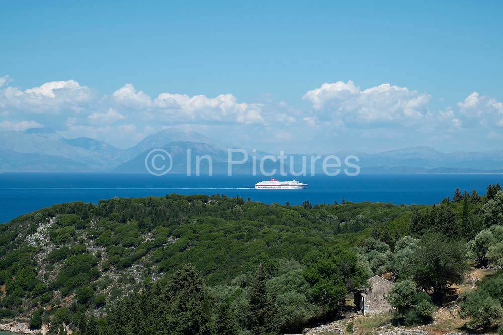 View out across the Ionian Sea towards the nearby islands and mainland at Rachi, near Kioni in Ithaca Greece. Ithaca, Ithaki or Ithaka is a Greek island located in the Ionian Sea to the west of continental Greece. Ithacas main island has an area of 96 square kilometres. It is the second-smallest of seven main Ionian Islands.