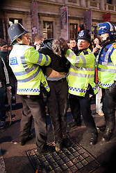 "© under license to London News Pictures. 25/03/2011: A UKUncut protester who had occupied Fortnum and Mason in Piccadilly is arrested and dragged away by police during a day of widespread anticuts protests. Protesters said that the company that owns Fortnum and Mason avoids £10 million in corporation tax annually, by being registered in Luxemburg. Credit should read ""Joel Goodman/London News Pictures""."