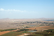 Israel, Golan Heights, The Valley of Tears (Emek Habacha) on the Syrian border site of a fierce battle in the Yom Kippur war of 1973 As seen from Mount Bental. New Quneitra in the background