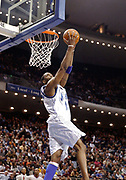 April 11, 2002, Orlando, Florida, USA;  Tracy McGrady goes airborne for a behind the head dunk against the New Jersey Nets for two of his 39 points in the Magic 101-99 loss to the Nets.