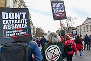 Demonstrators gather to protest against the extradition of Wikileaks founder Julian Assange, in London, Saturday, Feb. 22, 2020. Assange is fighting extradition to the United States on spying charges. (Photo/Vudi Xhymshiti)
