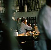 Busy restaurant scene, Silk Route, Turpan, Xinjiang Province, China.