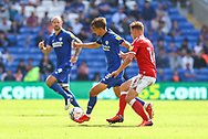 Cardiff City defender Tom Sang (28) under pressure from Bristol City's Cameron Pring (16) during the EFL Sky Bet Championship match between Cardiff City and Bristol City at the Cardiff City Stadium, Cardiff, Wales on 28 August 2021.
