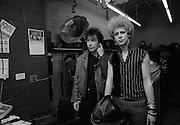 Photo of The Edge and Adam Clayton - U2 visiting a Juke Box store - Atlanta  USA - December 1981