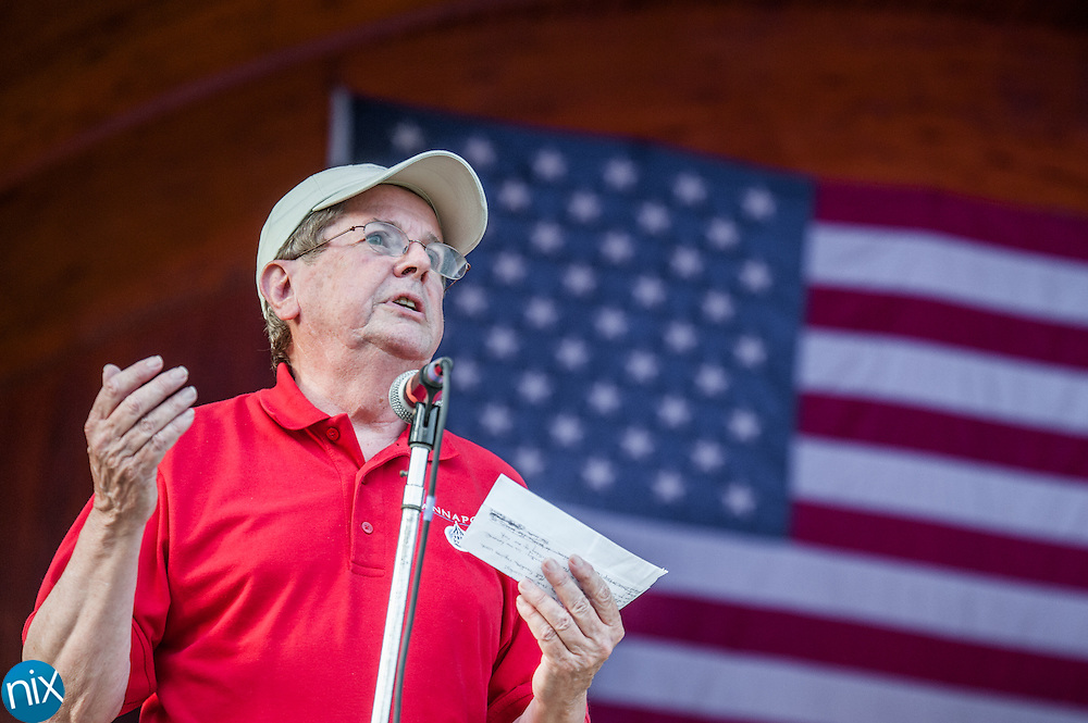 Kannapolis Mayor Darrell Hinnant speaks during the Symphonic Stars & Stripes Salute at Village Park in Kannapolis on July 2, 2014.