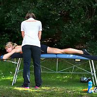 Nederland, Papendal, 06-08-2015.<br /> Atletiek, Training WK team Beijging.<br /> Daphne Schippers wordt behandeld.<br /> Foto : Klaas Jan van der Weij