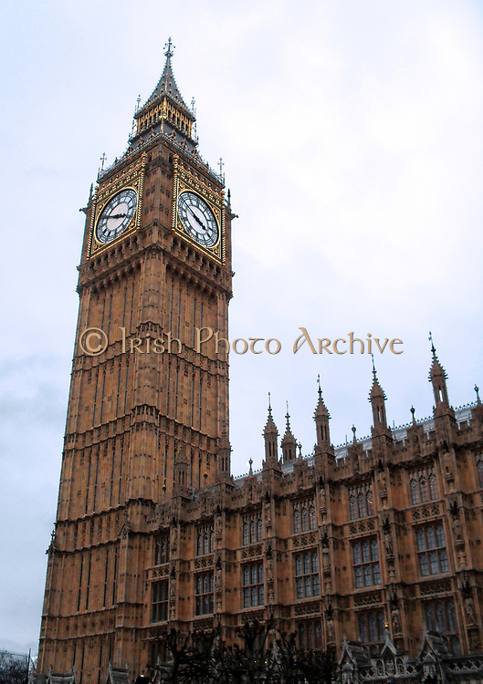 Big Ben with clock face visible in two sides of the tower at the British Houses of Parliament, London