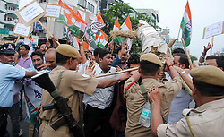 June 7, 2017 - Guwahati, India - Activists of Indian Youth Congress (IYC) being whisked away by police while staging a demonstration against detention of Congress Vice-President Rahul Gandhi in Madhya Pradesh, in front of Rajiv Bhawan in Guwahati. (Credit Image: © Rajib Jyoti Sarma/Pacific Press via ZUMA Wire)