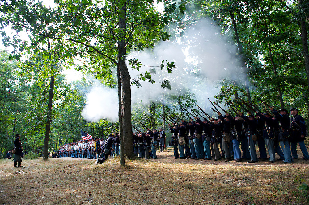 Union trops fire a practice round before marching into battle on the second day of the 149th Gettysburg Reenactment in Gettysburg, Pennsylvania on July 7, 2012.