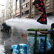 Turkish riot police use water cannon to disperse protestors during an anti-government protest at Taksim Square in Istanbul, Turkey, 06 July 2013. Photo by AYKUT AKICI/TURKPIX