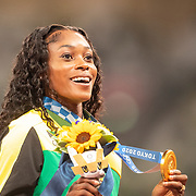 TOKYO, JAPAN August 1: Elaine Thompson-Herah of Jamaica on the podium with her gold medal after winning the 100 Final for women during the Track and Field competition at the Olympic Stadium  at the Tokyo 2020 Summer Olympic Games on July 31, 2021 in Tokyo, Japan. (Photo by Tim Clayton/Corbis via Getty Images)