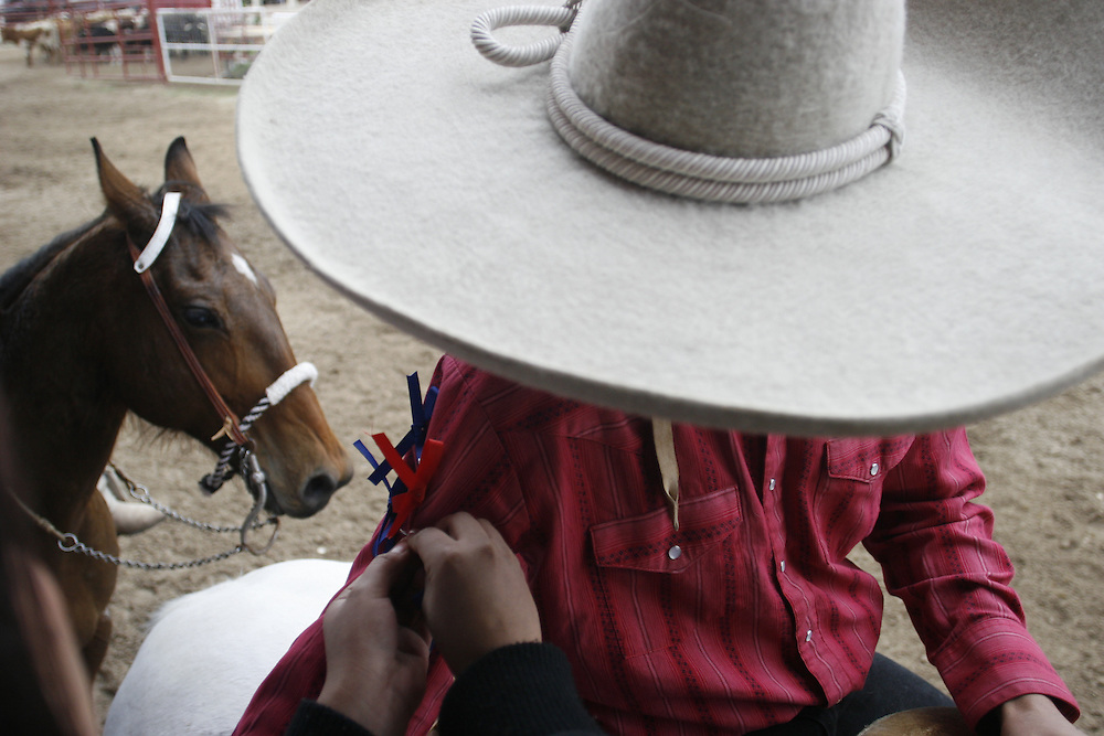 Julia Robinson photo.Each ribbon notes a successful run at a coleadero in Comfort, Texas.  Unlike the American rodeo, charros compete for bragging rights and the pride of their team instead of cash purses.