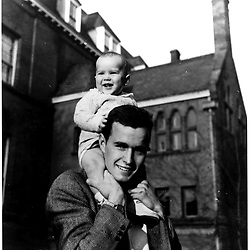 H075-03     George W. Bush sits on his father's shoulders in New Haven, CT., 10 Apr 47.<br /> Photo Credit:  George Bush Presidential Library