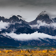 An autumn storm clears for a moment to allow the peaks of the Teton Range to appear in Grand Teton National Park, Wyoming.