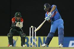 March 14, 2018 - Colmbo, Sri Lanka - Indian cricket captain Rohit Sharma plays a shot during the 5th Twenty-20 cricket match of NIDAHAS Trophy between Bangladesh and India at R Premadasa cricket ground, Colombo, Sri Lanka on Wednesday 14 March 2018. (Credit Image: © Tharaka Basnayaka/NurPhoto via ZUMA Press)