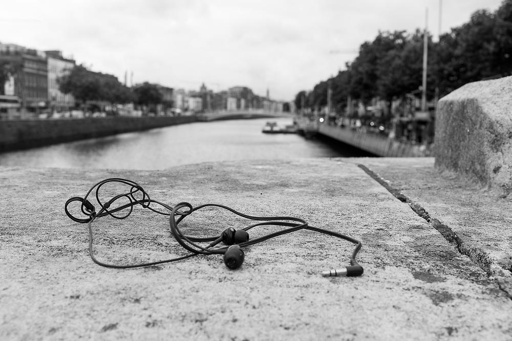 Lost ear buds on the O'Connell bridge, Dublin, Ireland.