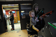 Locals Chrissy Kirby and her two year old son Anthony hunt for buck in the game room at the TA Travel Centers of America in Morris, Illinois.
