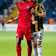 Kasimpasa's Veysel Sarş (L) and Fenerbahce's Caner Erkin (R) during their Turkish Superleague soccer match Kasimpasa between Fenerbahce at the Recep Tayyip Erdogan stadium in Istanbul Turkey on Sunday 13 September 2015. Photo by Aykut AKICI/TURKPIX