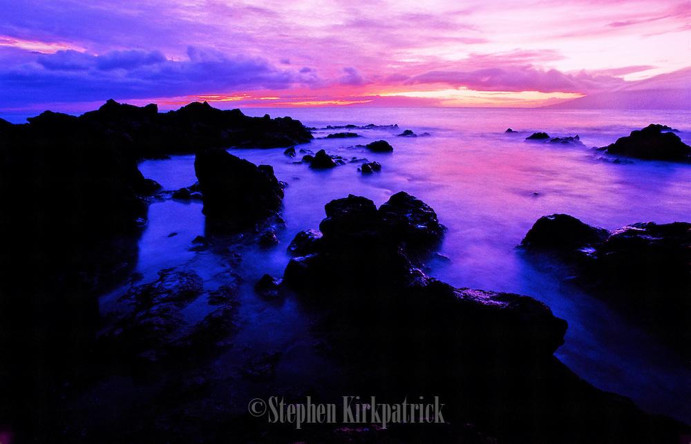 Surf at sunset on the rocky shore - Waimea, Maui