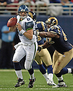 Seahawks quarterback Matt Hasselbeck (8) steps up in the pocket, away form Rams nose tackle Damione Lewis (92) during game action at the Edward Jones Dome in St. Louis, Missouri, October 9, 2005.  The Seahawks beat the Rams 37-31.
