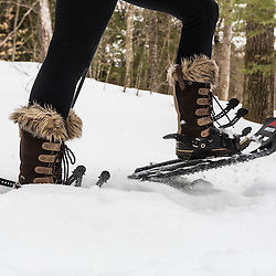 Snowshoeing on a forest trail in Epping, New Hampshire.