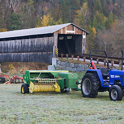 A tractor in front of the Mount Orne covered bridge in Lancaster, Vermont.  Connecticut River.