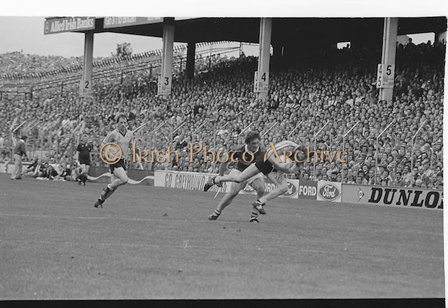 Dublin player falls to the ground after catching the ball during the All Ireland Senior Gaelic Football Championship Final Kerry v Dublin at Croke Park on the 22nd September 1985. Kerry 2-12 Dublin 2-08.