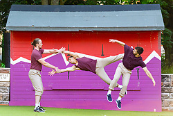Edinburgh, Scotland, UK. 3 August  2021.  Performers from the experimental acrobatic circus company Barely Methodical Troupe perform outside the Palais du Variété Spiegeltent in George Square Gardens to kick off the Assembly Festival's summer Fringe programme. The Troupe are performing their cutting edge show Bromance that wittily explores male companionship and its limits. Iain Masterton/Alamy Live news.