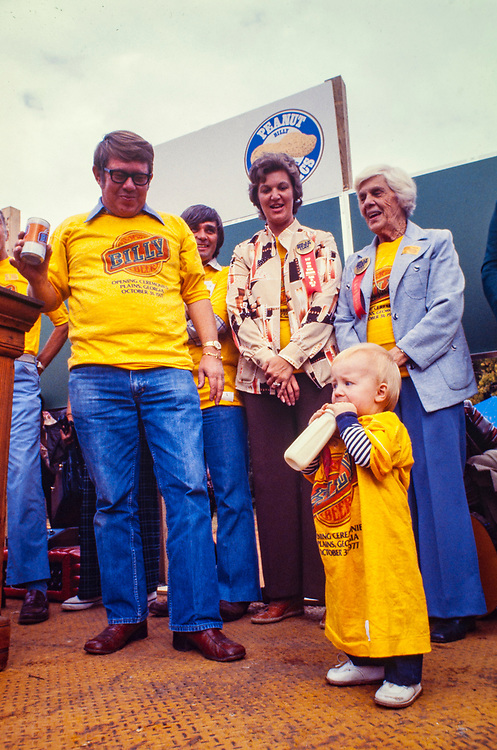 """Billy Carter, his wife Sybil, mother Lillian and son Earl at the October 1977 kickoff of Billy Beer. William Alton - Billy - Carter (March 29, 1937 – September 25, 1988) was an American farmer, businessman, brewer, and politician, and the younger brother of U.S. President Jimmy Carter. Carter promoted Billy Beer and was a candidate for mayor of Plains, Georgia. Carter was born in Plains, Georgia, to James Earl Carter Sr. and Lillian Gordy Carter. He was named after his paternal grandfather and great-grandfather, William Carter Sr. and William Archibald Carter Jr. respectively. He attended Emory University in Atlanta but did not complete a degree. He served four years in the United States Marine Corps, then returned to Plains to work with his brother in the family business of growing peanuts. In 1955, at the age of 18, he married Sybil Spires (b. 1939), also of Plains. They were the parents of six children: Kim, Jana, William """"Buddy"""" Carter IV, Marle, Mandy, and Earl, who was 12 years old when his father died."""