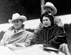 File photo dated 21/10/51 of the then Princess Elizabeth and the Duke of Edinburgh watching a 'stampede' rodeo staged especially for them in Calgary, Alberta, during their tour of Canada. The couple had a strong bond but were different in character and the Duke of Edinburgh never shied away from telling his wife exactly what was what. Issue date: Friday April 9, 2021.