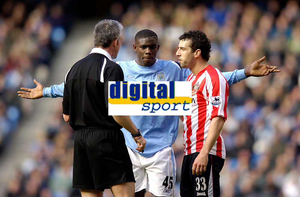 Photo: Jed Wee.<br /> Manchester City v Sunderland. The Barclays Premiership. 05/03/2006.<br /> <br /> Sunderland's Julio Arca (R) pleads his case to the referee Chris Foy (L) as Manchester City's Micah Richards tries to get action taken against the Sunderland player.