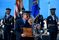 "Air Force Chief of Staff Gen. David L. Goldfein presents <br /> Mrs. Doris Day the Brig Gen. rank of her husband Colonel George E. ""Bud"" Day, retired and deceased, during the 2018 Heritage to Horizons summer concert in Arlington, Va., June 8, 2018. The stars were originally Goldfein's when he was a Brig. Gen. (U.S. Air Force photo by Wayne A. Clark)"