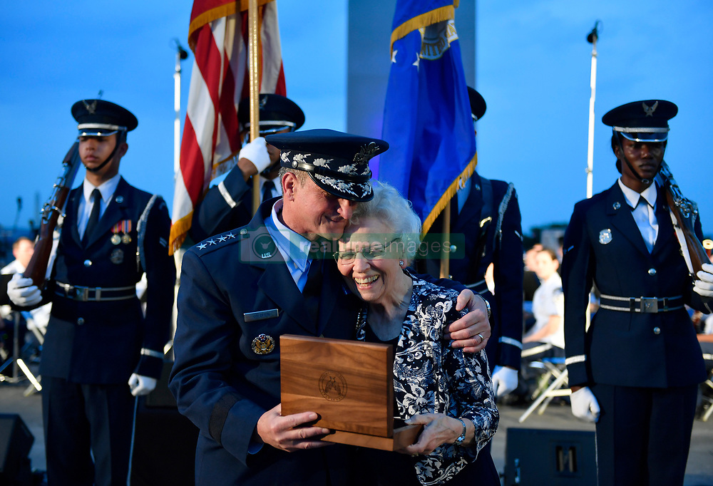 """Air Force Chief of Staff Gen. David L. Goldfein presents <br /> Mrs. Doris Day the Brig Gen. rank of her husband Colonel George E. """"Bud"""" Day, retired and deceased, during the 2018 Heritage to Horizons summer concert in Arlington, Va., June 8, 2018. The stars were originally Goldfein's when he was a Brig. Gen. (U.S. Air Force photo by Wayne A. Clark)"""