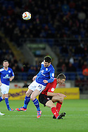 Leicester's David Nugent collides with Cardiff's Ben Nugent. NPower championship, Cardiff city v Leicester city at the Cardiff city stadium in Cardiff, South Wales on Tuesday 12th March 2013.  pic by  Andrew Orchard, Andrew Orchard sports photography,