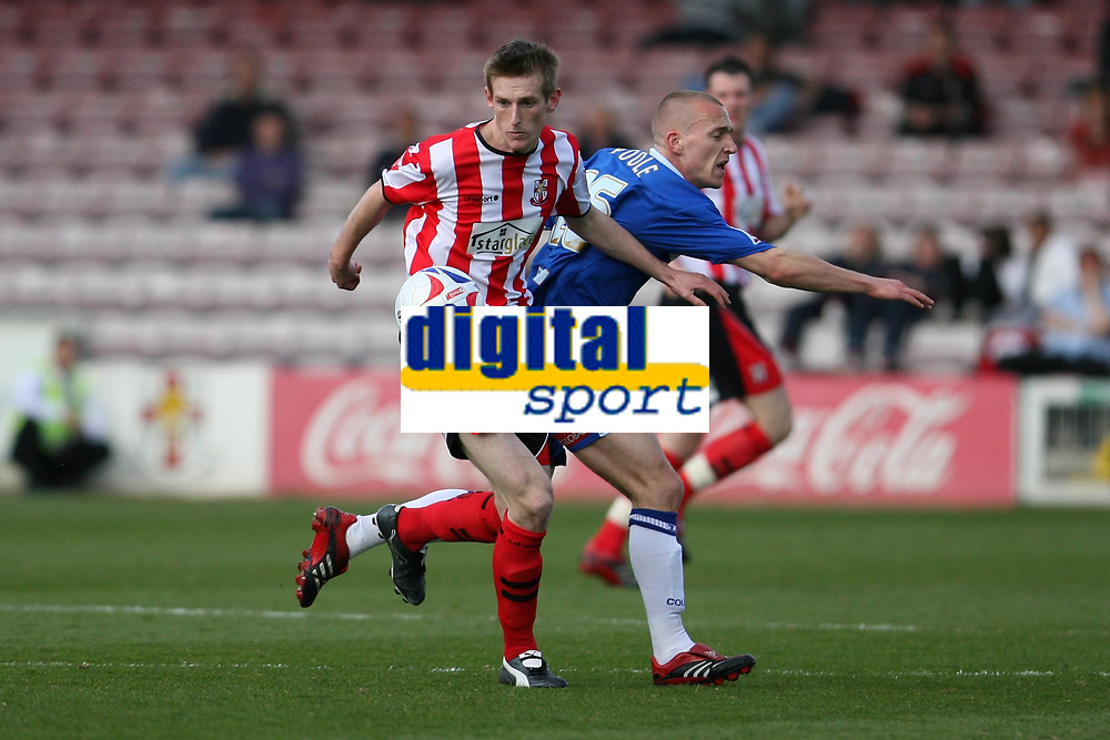 Photo: Pete Lorence.<br />Lincoln City v Stockport County. Coca Cola League 2. 07/04/2007.<br />Jeff Hughes and David Poole in action.