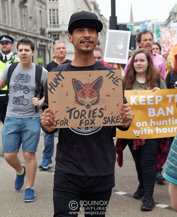 London, United Kingdom - 29 May 2017<br /> Members of the Hunt Saboteurs Association and other anti-hunting protestors march through central London to protest against the Conservative Party's manifesto promise to lift the ban on fox hunting. The protesters slogan is #keeptheban. They marched from Cavendish Square to Downing Street, Whitehall, London, England, UK.<br /> www.newspics.com/#!/contact<br /> (photo by: EQUINOXFEATURES.COM)<br /> Picture Data:<br /> Photographer: Equinox Features<br /> Copyright: ©2017 Equinox Licensing Ltd. +448700 780000<br /> Contact: Equinox Features<br /> Date Taken: 20170529<br /> Time Taken: 12522034