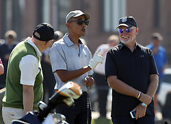 Sir Tom Hunter (right) and former US president Barack Obama playing a round of golf at the Old Course in St Andrews, Fife.