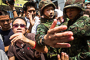 25 MAY 2014 - BANGKOK, THAILAND:  Anti-coup protestors and soldiers clash in Bangkok. Public opposition to the military coup in Thailand grew Sunday with thousands of protestors gathering at locations throughout Bangkok to call for a return of civilian rule and end to the military junta.    PHOTO BY JACK KURTZ