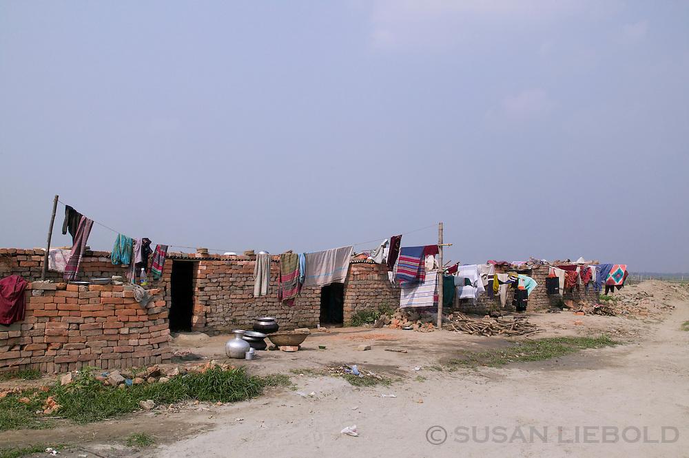 Makeshift lodging for workers at a brick making factory outside Dhaka, Bangladesh.