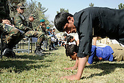 Candidates for ANA officer cadet school take fitness tests given by Turkish NATO soldiers at the National Military Academy of Afghanistan (NMAA), modeled on the US Military Academy at West Point.  Out of approximately 3,000 applicants only 300 are selected each year during three days of academics and fitness tests.  The first class will graduate in 2009 with four year degrees majoring in civil engineering, computer sciences and law.  By 2012 the campus will be housed in a new $150 - 200 million facility named the Afghan Defense University (ADU).  The school is run by Afghan instructors with mentors from ISAF NATO forces.