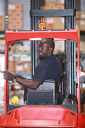 Warehouse worker on forklift truck UK