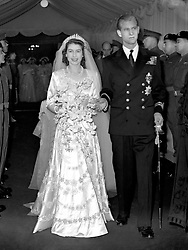 File photo dated 20/11/1947 of Queen Elizabeth II and The Duke of Edinburgh leaving Westminster Abbey after their wedding ceremony as they are celebrating their 69th wedding anniversary today.