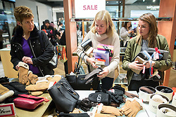 © Licensed to London News Pictures . 26/12/2015 . Manchester , UK . Bargain hunters scooping up handbags in the Selfridges winter sale . Photo credit: Joel Goodman/LNP