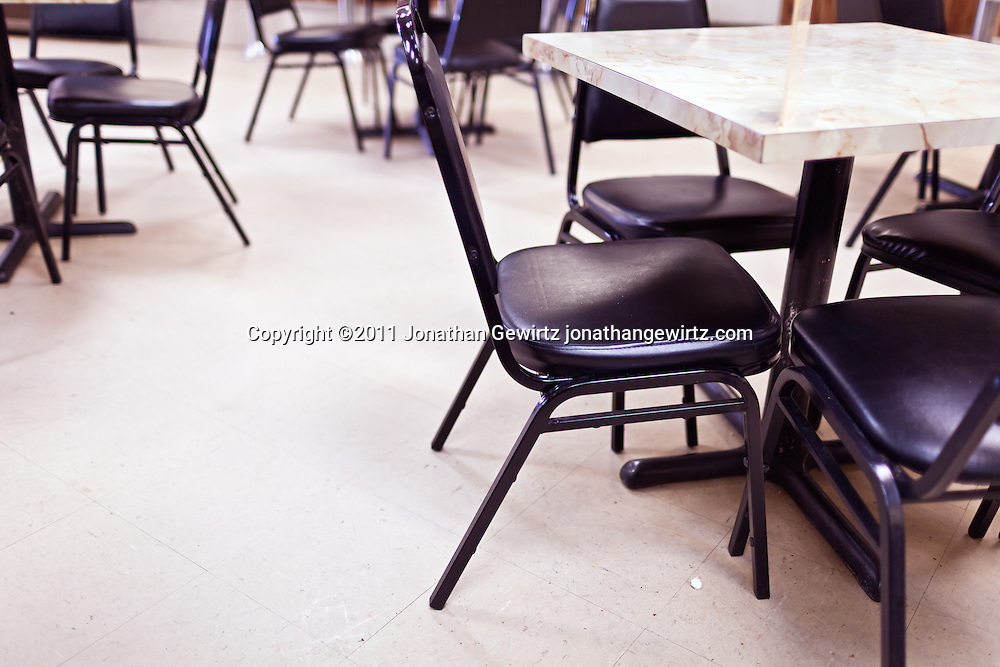 Tables and chairs in a deli-style restaurant. WATERMARKS WILL NOT APPEAR ON PRINTS OR LICENSED IMAGES.