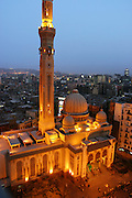Muslims gather to pray at Al Fath Mosque in central Cairo. Hungry Planet: What the World Eats (p. 120).