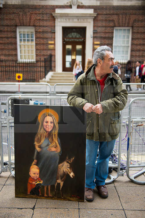 25/04/2015. Artist Kaya Mar poses with his painting of The Duchess of Cambridge, outside the Lindo Wing of St Mary's hospital in Padding, where The Duchess is due to give birth. Photo credit: Ben Cawthra